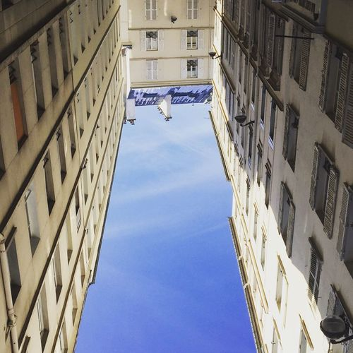Symetry Imagine Sky And Building Snowyroofs Lookingup Building Exterior Built Structure Outdoors Sky