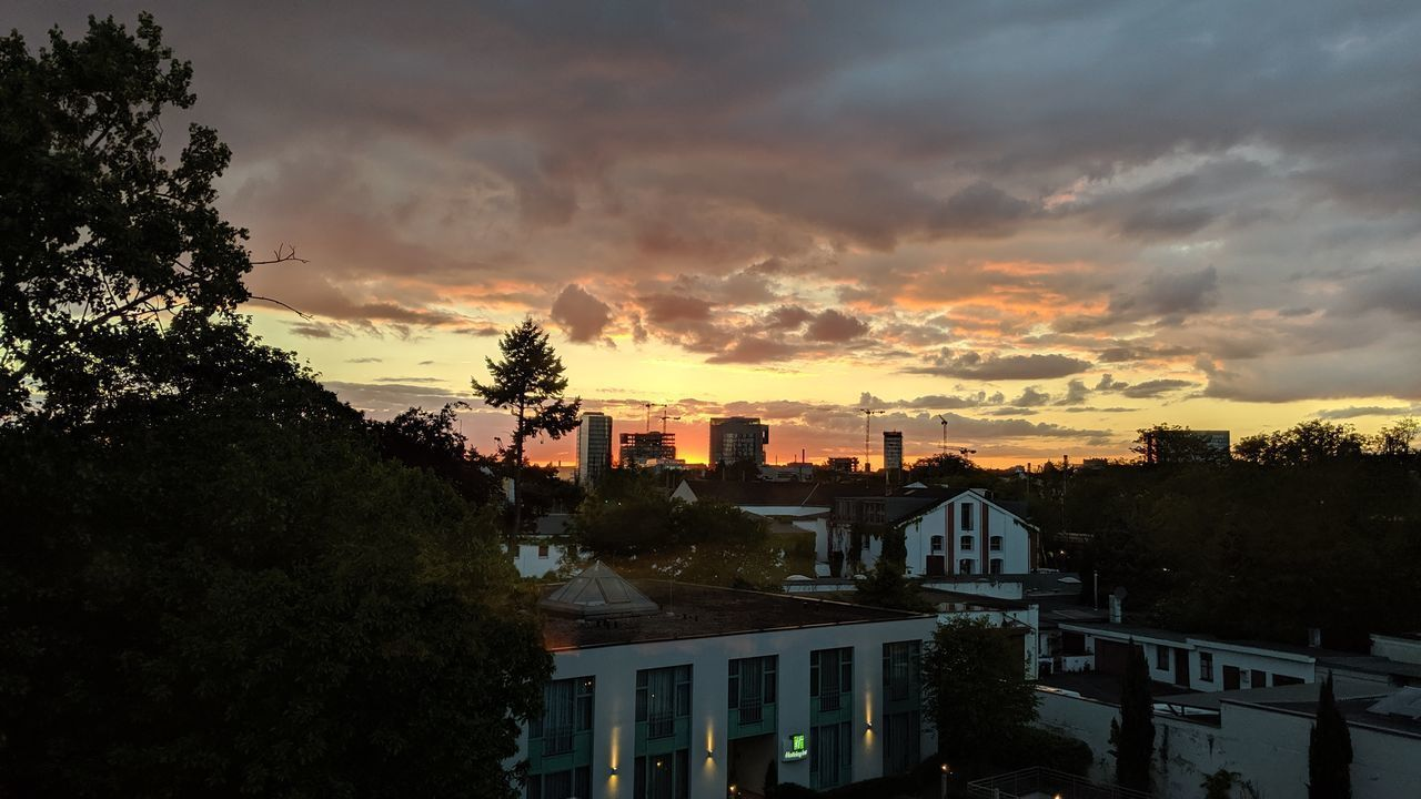 sky, cloud - sky, built structure, tree, building exterior, sunset, architecture, plant, building, nature, no people, residential district, city, outdoors, beauty in nature, high angle view, orange color, house, growth, silhouette