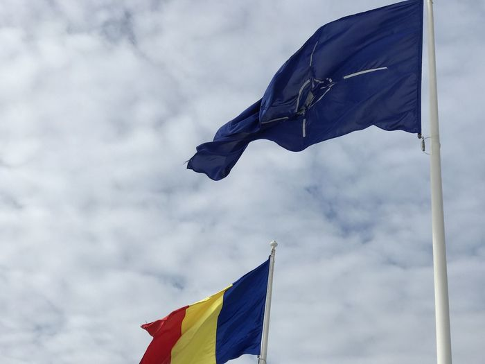 NATO North Atlantic Romania Cloud - Sky Day Emotion Environment Flag Low Angle View Motion National Icon Nature No People Outdoors Patriotism Pole Pride Shape Sky Star Shape Waving Wind