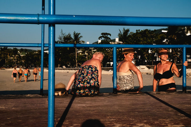 Last day in Thailand, sunset at Patong Beach. I spotted these ladies taking in the last rays of the sun. Beach Beachphotography Candid Patong Phuket Sky Spontaneous Spotted In Thailand Street Streetphotography Sunset Thailand Tourists Unstaged The Street Photographer - 2016 EyeEm Awards My Year My View