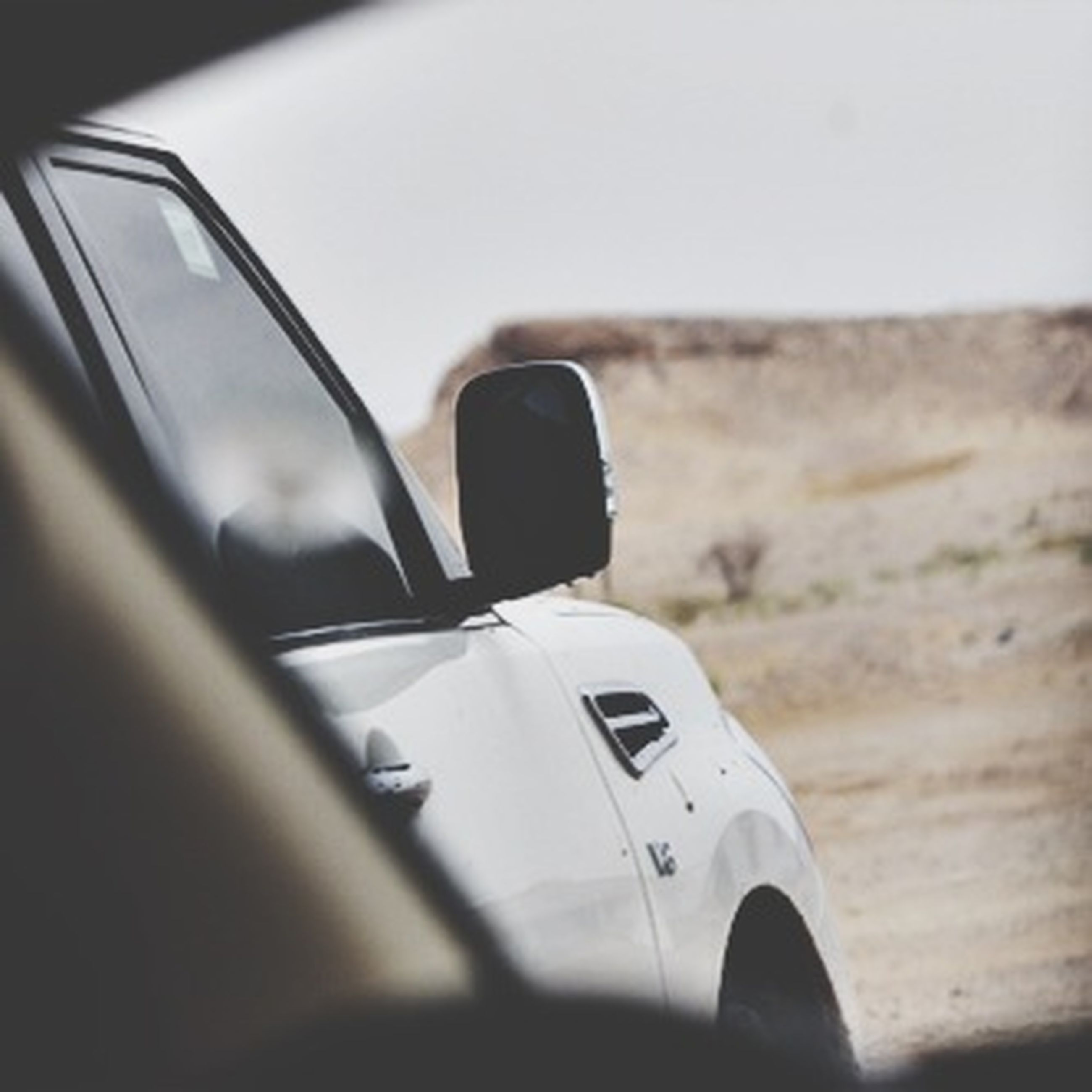 transportation, mode of transport, car, technology, close-up, focus on foreground, land vehicle, photography themes, selective focus, vehicle interior, part of, travel, indoors, car interior, communication, wireless technology, day, camera - photographic equipment, cropped, journey
