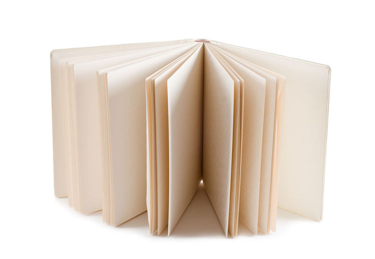 Wide open empty photo album with parchment sheets, ecru color hanmade object with blank pages. Blank Blank Pages Blank Paper Ecru Empty Handmade Memories No People Nobody Object Open Pages Parchment Photo Photoalbum Photograph Photography Scrapbook Sheet Sheets Sheetsofpaper Vellum
