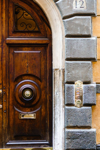 Door Bell Architecture Building Exterior Close-up Closed Day Door Entrance Knockers And Knobs No People Stone Wood - Material