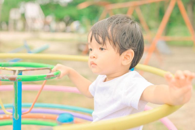 Cute boy playing outdoors
