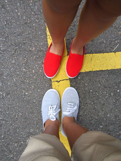 Casual Clothing Footwear High Angle View Human Foot Leisure Activity Lifestyles Low Section Person Red Shoe Standing Street Togetherness