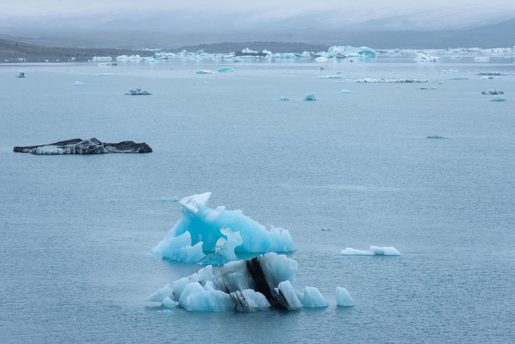 Scenic view of ice floating on sea