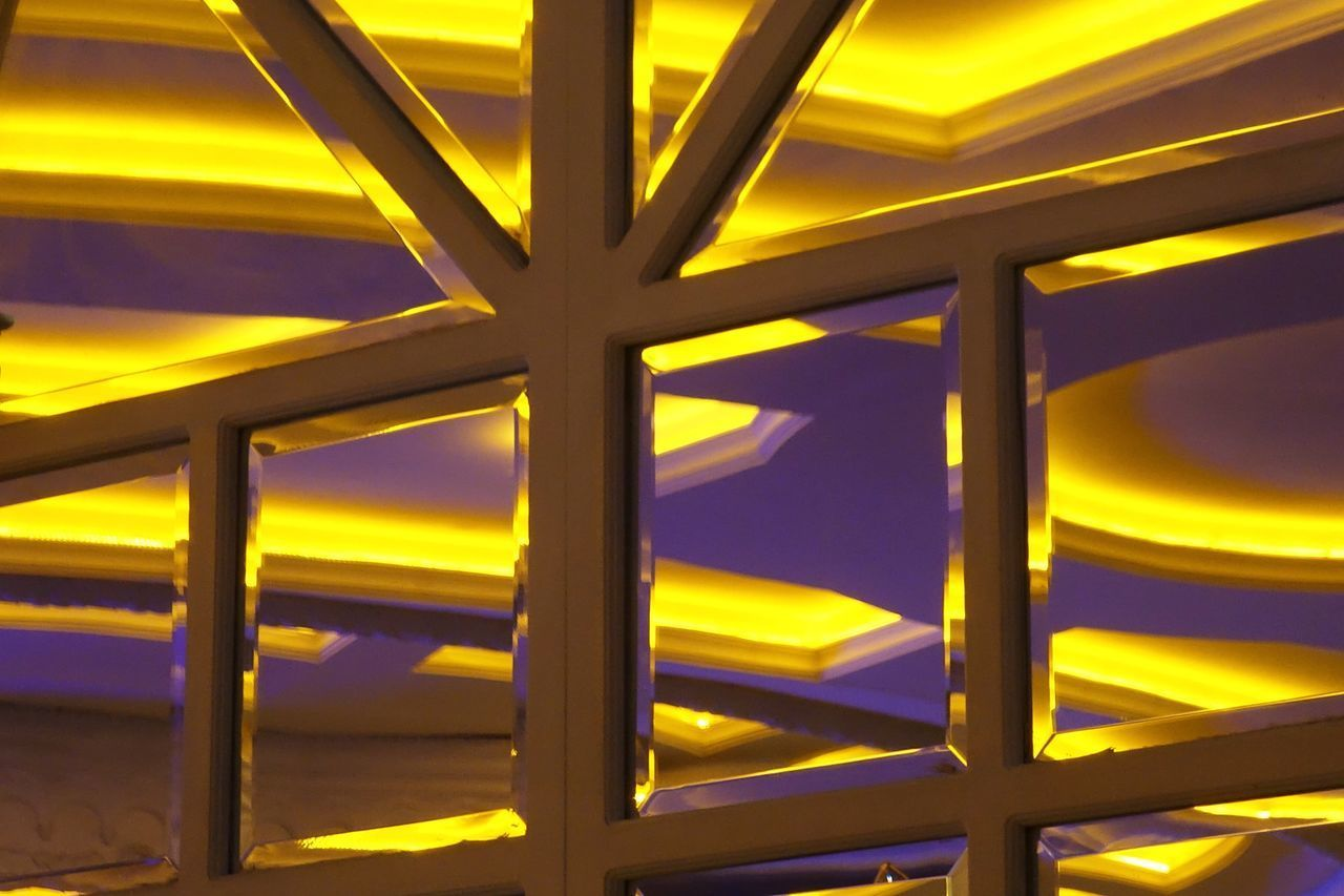 no people, yellow, full frame, illuminated, pattern, indoors, architecture, built structure, backgrounds, low angle view, sunset, close-up, metal, sky, lighting equipment, design, day, glowing, ceiling