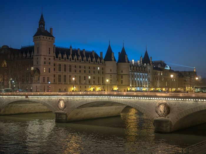 Architecture Illuminated Water Building Exterior Built Structure Night Clear Sky City River Travel Destinations Sky Bridge - Man Made Structure France Paris Paris, France  EyeEm Gallery EyeEm Best Shots Capture The Moment EyeEmBestPics I Love My City The Changing City Cityscape Outdoors Conciergerie The City Light