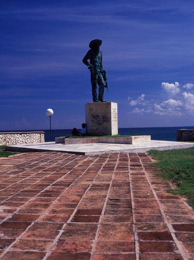resting covert by the statue of al commandant Camilo... Al Commandante Camilo Architecture Blue Sky Freedom Fighter Have A Break HERO Man Outdoors Place Of Worship Resting Resting Man Road To Nowhere Sea Sea And Sky Sky Statue Vertical