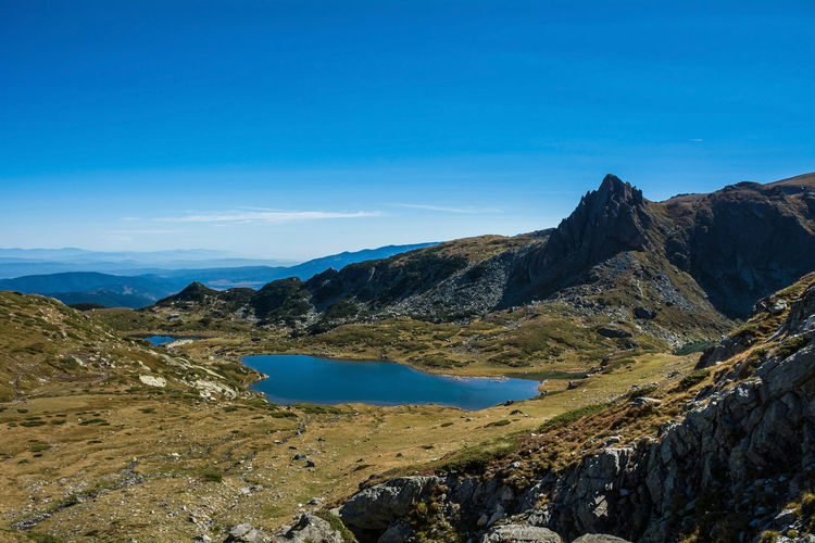 Seven Rila Lakes, Bulgaria The Trefoil Трилистника (Trilistnika) 2,216 m (7,270 ft) 2.6 ha (6.4 acres) 6.5 m (21 ft) Scenics - Nature Mountain Sky Tranquil Scene Beauty In Nature Tranquility Water Non-urban Scene Blue Nature Idyllic Mountain Range No People Day Environment Landscape Rock Lake Remote Outdoors Formation Lake View Nature Nature_collection Nature Photography