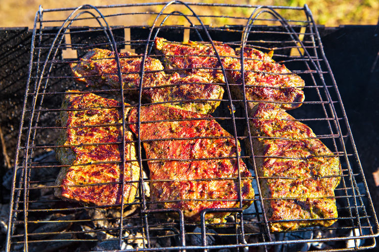 Meat Barbecue Barbecue Grill Food Food And Drink Grilled Heat - Temperature Preparation  No People Freshness Day Outdoors Close-up High Angle View Metal Red Meat Preparing Food Focus On Foreground Meal Burning Beef Char-grilled Rib Dinner