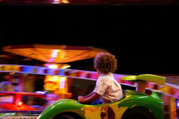 Funfair Colorlight Children Photography Littleboy Enjoying Life Innocence Kids Being Kids Curly Hair