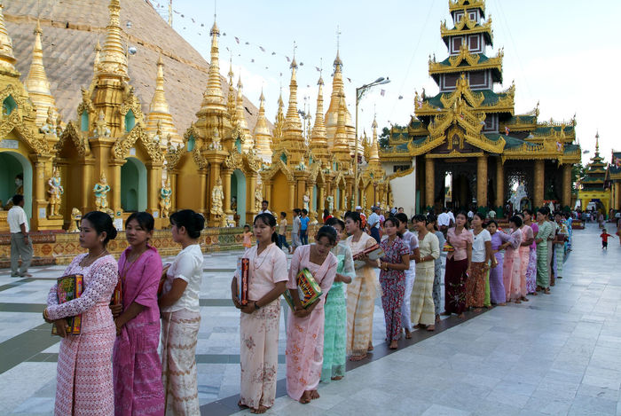 Pagoda Yangon Architecture Building Exterior Built Structure Burma Day Gold Colored Large Group Of People Lifestyles Men Myanmar Outdoors Place Of Worship Real People Religion Shwedagon Sky Spirituality Travel Destinations Women