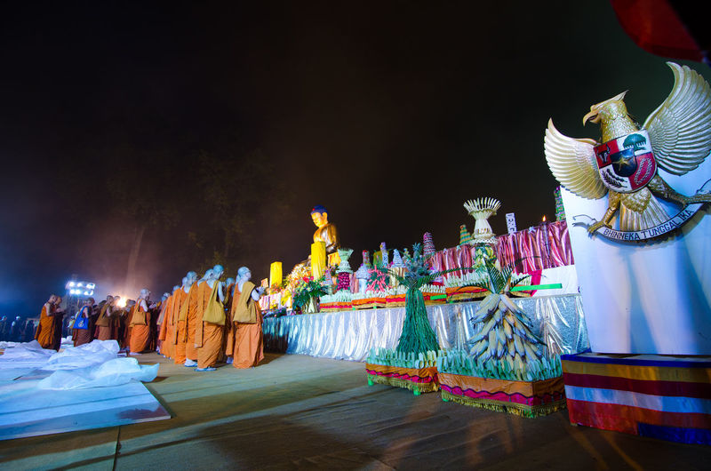 15 may 2014, Magelang, Indonesia : Participants releasing lanterns over the Borobudur temple in Magelang, Central Java during Vesak/Waisak Day celebrations Architecture Art And Craft Belief Building Built Structure Craft Creativity Human Representation Illuminated Male Likeness Night No People Place Of Worship Religion Representation Sculpture Spirituality Statue