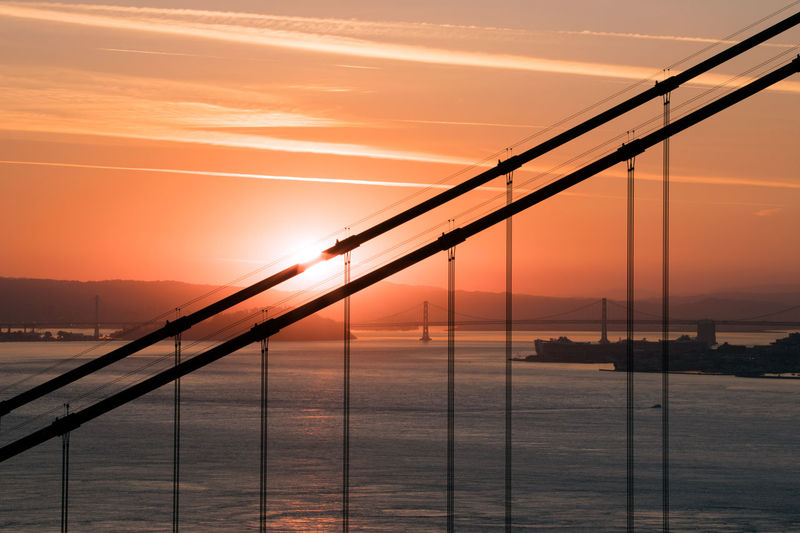 California Golden Gate Bridge Architecture Bay Beauty In Nature Bridge Bridge - Man Made Structure Built Structure Cloud - Sky Connection Nature No People Orange Color Outdoors Sailboat Scenics - Nature Sea Sky Sun Sunrise Sunset Tranquility Transportation Water