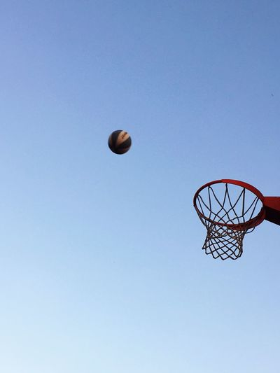 Basket ball against sky Basketball - Sport Basketball Hoop Low Angle View Copy Space Ball Clear Sky Sport Day Making A Basket Blue Outdoors Court No People Sky