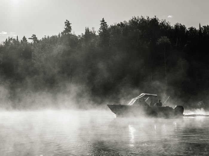 Scenic view of fishing boat in foggy weather