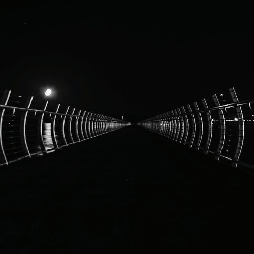 The Breakwater In A Row Night Illuminated Outdoors No People Darkness Walk This Way Breakwaters Metalwork