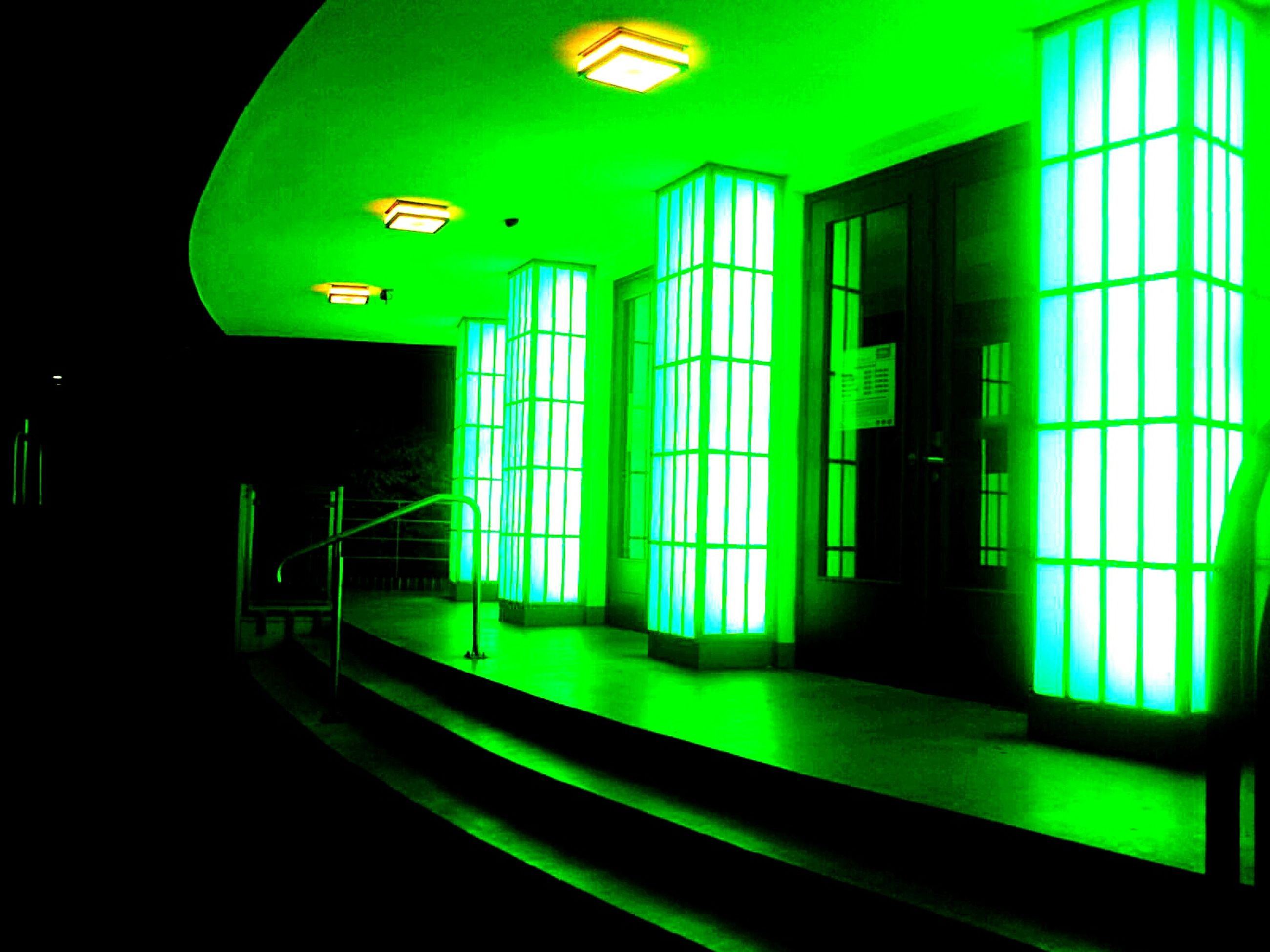 window, lighting equipment, green color, illuminated, indoors, home interior, flooring, corridor, back lit, electric light, multi colored, green, vibrant color, geometric shape, interior design