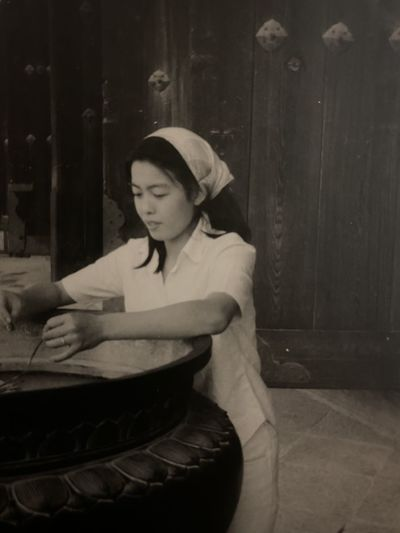 Young woman looking down while sitting at home
