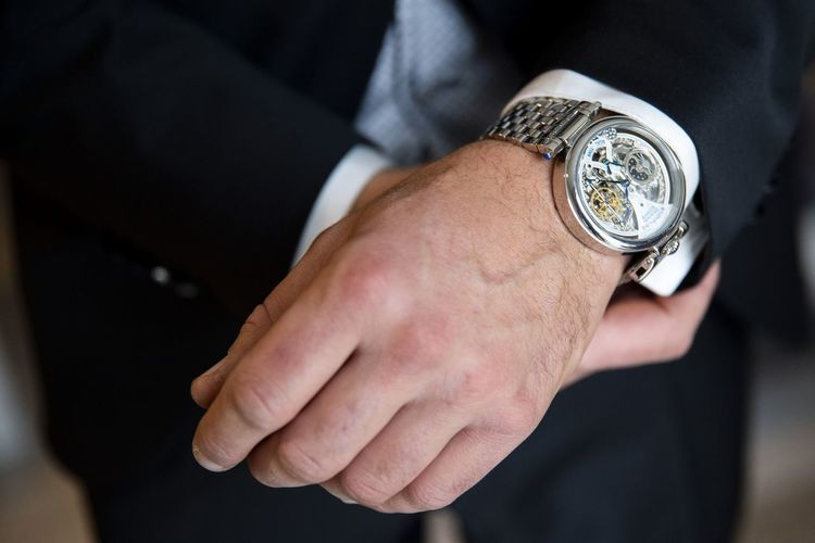 close-up on the hands of a gentleman who attaches his watch Nikon Work Nikonphotography Lifestyles Streetphotography Portrait Nikonphotographer Colors Human Hand Clock Face Time Wristwatch Watch Black Background Business Business Finance And Industry Midsection Close-up Redefining Menswear