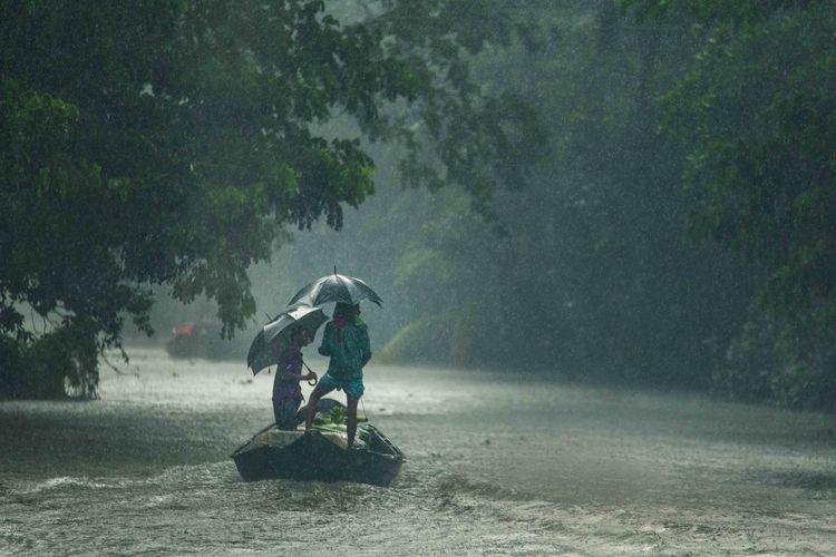Full length of man with umbrella during rainy season