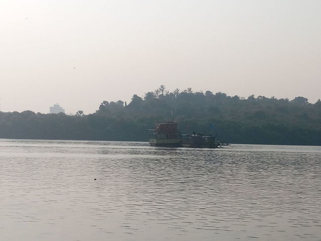 Boat Clear Sky Copy Space Distant Journey Mode Of Transport Mountain Mountain Range Nautical Vessel Outdoors Pagoda Relaxing Moments Sand Sea Tranquil Scene Tranquility Transportation Trip Vacations Water Waterfront