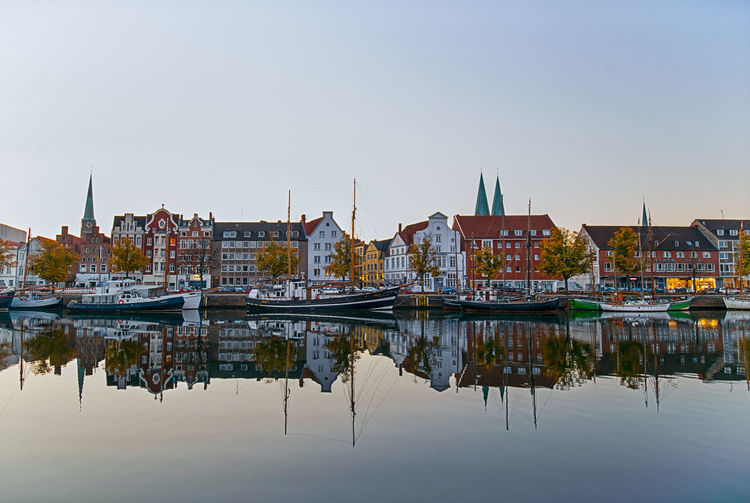 A New Beginning Architecture Architecture_collection Lübeck Untertrave Sunrise Water Reflections Waterfront Germany Europe Medieval Architecture MedievalTown City Cityscape City Life Boats Ships Water City Reflection Sky Canal Calm Nautical Vessel Sailing Boat
