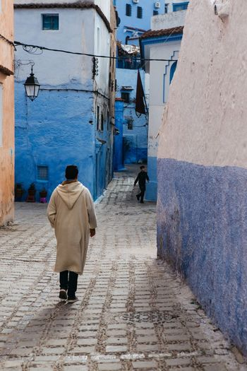 Chefchauen 💙 Travel Chefchaouen Morocco Architecture Built Structure Building Exterior Only Men Adult One Man Only Real People One Person People Outdoors Day The Street Photographer - 2018 EyeEm Awards