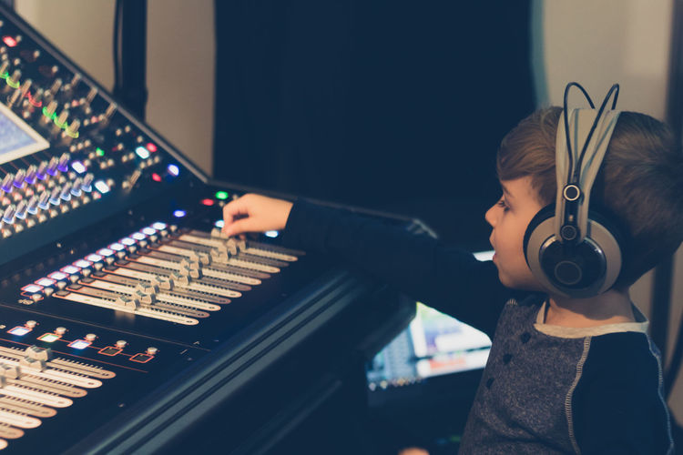 Headphones Audio Audio Equipment AudioEngineer Dj Editing Learning Music Sound Sound Mixing Switch Adjusting Boy Broadcasting Child Childhood Control Panel Kid Mixing Console Music Studio  Producer Radio Station Recording Studio Sound Mixer Technology Volume Club Dj Sound Recording Equipment Radio DJ Amplifier