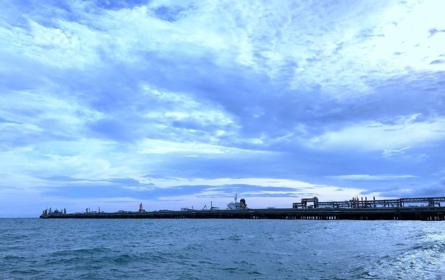 Industrial complex Industrial Complex Peer Cloud - Sky Sky Water Sea Beauty In Nature Scenics - Nature Nature Waterfront Tranquil Scene No People