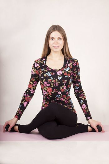 Only Women One Woman Only One Person Full Length People Adult Adults Only Portrait Healthy Lifestyle Front View Yoga Indoors  Smiling Lifestyles One Young Woman Only Sitting Looking At Camera Exercising Wellbeing Young Adult Https://www.instagram.com/vorobeva_foto/long Hair Gray Background Studio Shoot Real People Beautiful People