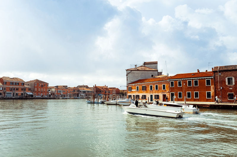 View of sailboat in venice against cloudy sky