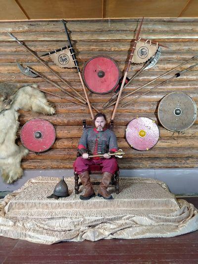 Portrait of boy sitting on wooden floor