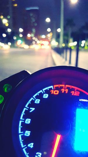 Bokeh tachometer (samsung s6 shot) Mode Of Transport Car Transportation Land Vehicle Illuminated Speedometer Part Of Dashboard Night Travel Road Close-up Cropped Street Control On The Move Steering Wheel Gauge Outdoors Journey