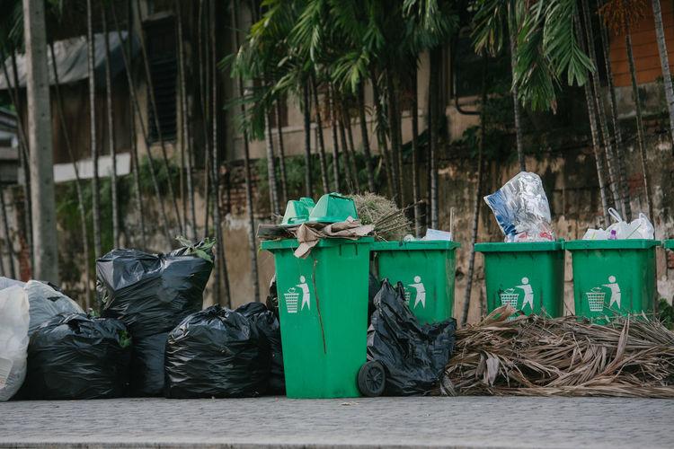 Garbage bin against building in city