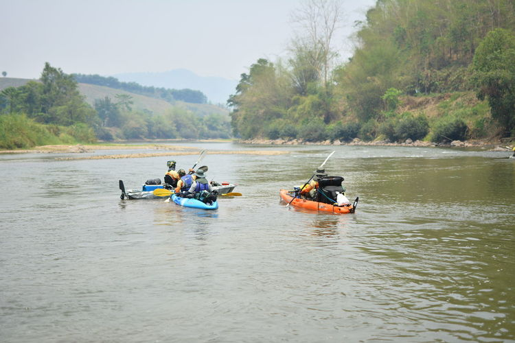 Water Outdoors Chiang Rai, Thailand Transportation Nautical Vessel Mode Of Transportation Waterfront Group Of People Tree Day Men River Plant Real People Nature Adventure Lifestyles Leisure Activity Beauty In Nature People Inflatable