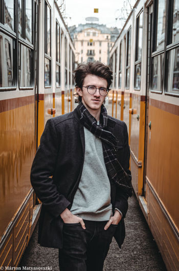 Portrait of man standing on train