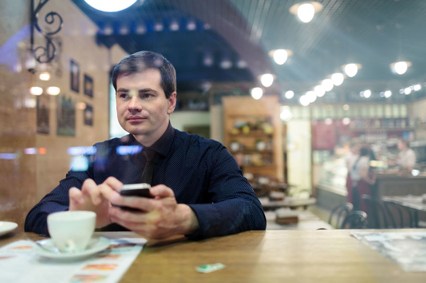 Businessman Businesspeople Cafe Cafeteria Caucasian Cell Coffee Coffee Break Male Man Mobile Phone Restaurant Smartphone SMS