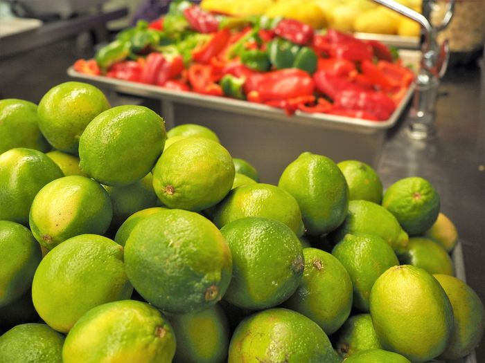 Limes Abundance Close-up Day Food Food And Drink For Sale Freshness Fruit Green Color Healthy Eating Indoors  Large Group Of Objects Lime Market Market Stall No People