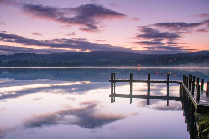 Lake District Ullswater Beauty In Nature Cloud - Sky Dawn Idyllic Lake Mountain Nature No People Non-urban Scene Orange Color Outdoors Pier Reflection Scenics - Nature Sky Standing Water Sunset Tranquil Scene Tranquility Water Waterfront Wooden Post