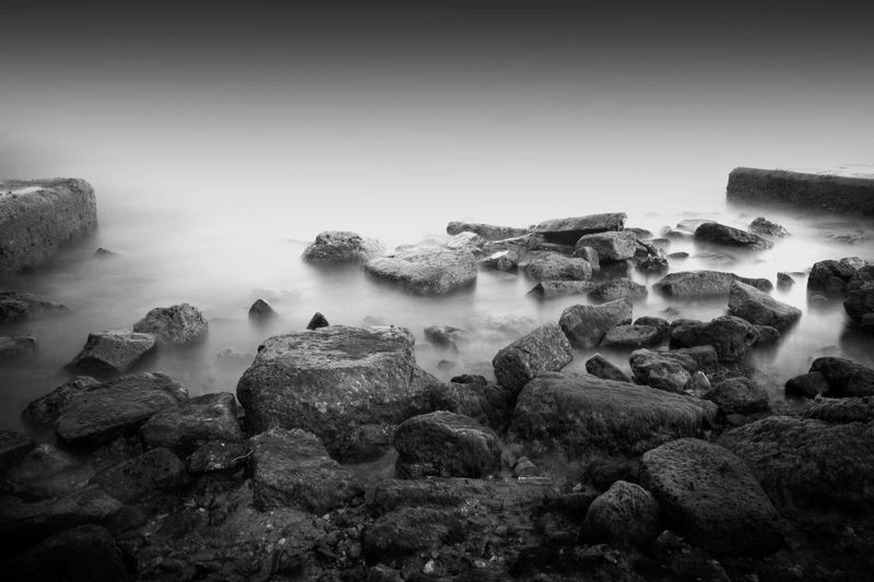 Beauty In Nature Black And White Nature Black And White Photography Day Fine Art Photography Long Exposure Long Exposure Shot Nature Outdoors Rock Rock - Object Seascape Photography Shore Silence Sky Stone Water