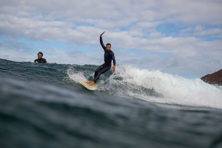 Leisure Activity Motion Cloud - Sky Sky Sport Lifestyles Beauty In Nature Splashing Nature Real People People Water Full Length Sea Fun Scenics - Nature Skill  Men Wave Outdoors Power In Nature Human Arm