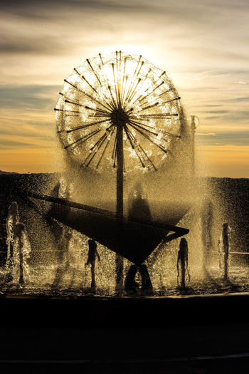 Castiglione Del Lago Adult Amusement Park Amusement Park Ride Architecture Arts Culture And Entertainment Building Exterior Day Ferris Wheel Fontain Fontana Men Outdoors People Real People Silhouette Sky Standing Sunset Sunsets Umbria Urban Water