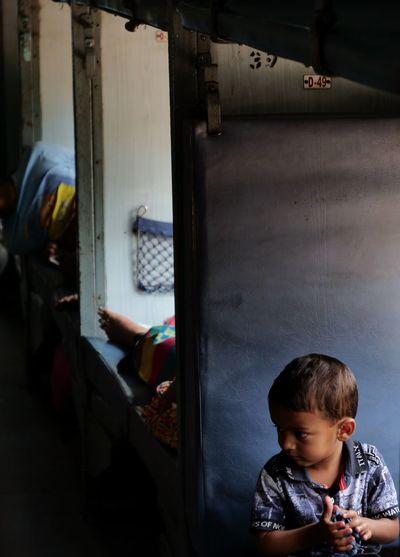 Train Indian Boy Sleeper Konkanrailway Konkan Railway India Transportation People Watching Childhood One Boy Only Boys Indoors  One Person Children Only People Child The Portraitist - 2018 EyeEm Awards