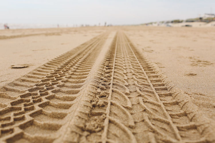 Arid Climate Beach Close-up Day Landscape Nature No People Outdoors Sand Sand Dune Sky The Way Forward Tire Track Track - Imprint Tracks