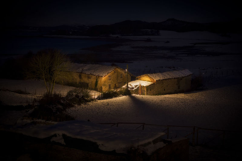 High angle view of illuminated buildings during winter