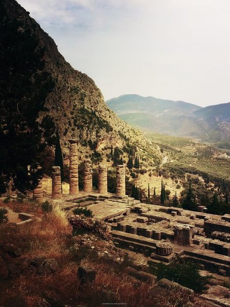 Oracle of Delphi. The Temple of Apollo overwhelmed in light. Delphi Oracleofdelphi Archaeological Sites Templeofapollo Temple Placeofworship Archaeologicalsiteofdelphi Oracle Heritage Civilization Ancientgreece History Greekhistory Templeruins Mountains Olive Tree Light Sky