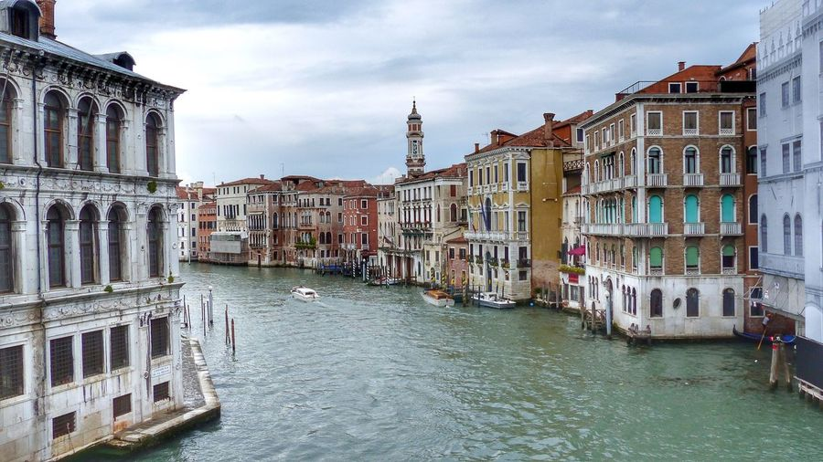 Grand canal amidst buildings against sky