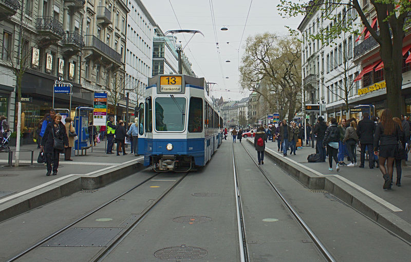Tramway And People On Street Amidst Buildings